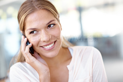 Buy stock photo Closeup shot of a young business professional talking on her mobile phone