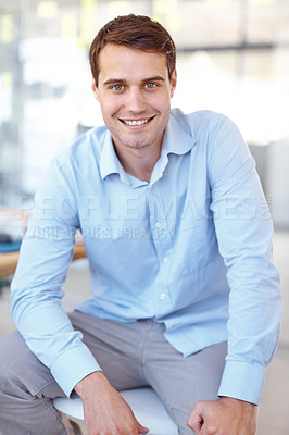 Buy stock photo Portrait of a handsome young business professional sitting in an office