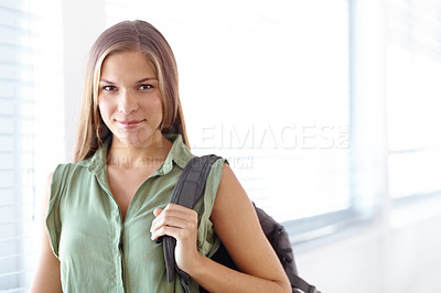 Buy stock photo Portrait of a female university student carrying a backpack and smiling at the camera