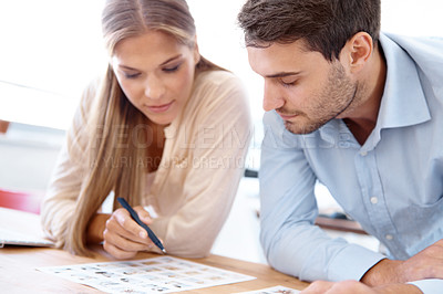 Buy stock photo Two business co-workers looking at images and having a discussion
