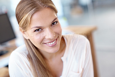 Buy stock photo Closeup of a lovely young businesswoman in an office smiling at the camera