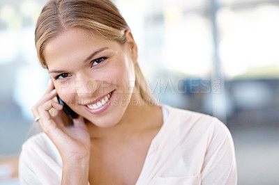 Buy stock photo Beautiful young businesswoman talking on a cellphone while smiling at the camera - copyspace
