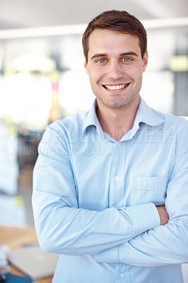 Buy stock photo Confident young businessman smiling with his arms folded - portrait