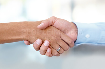 Buy stock photo Closeup cropped image of a man and a woman shaking hands