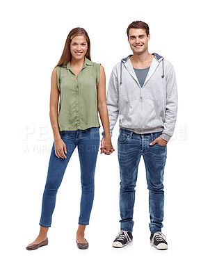 Buy stock photo Young casual couple holding hands - isolated