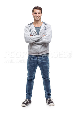 Buy stock photo Casual young man standing with his arms folded and smiling at the camera - isolated