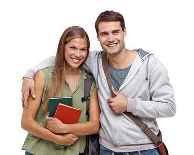 Buy stock photo Young student couple smiling while holding their textbooks - isolated
