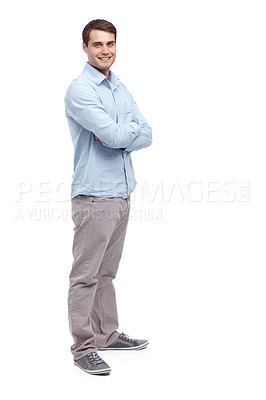 Buy stock photo Handsome young man standing with his arms folded and smiling at the camera - full length