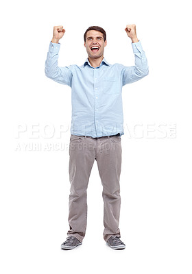 Buy stock photo Young man standing with his fists in the air in an expression of victory