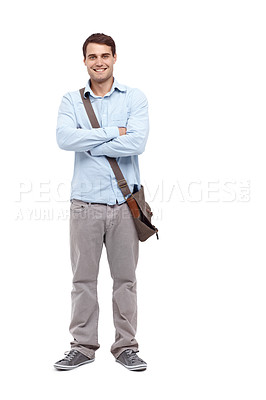 Buy stock photo Handsome young man wearing a satchel and smiling at the camera with his arms folded - full length