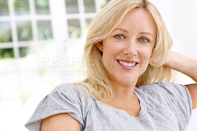Buy stock photo Portrait of a beautiful blond woman relaxing at home