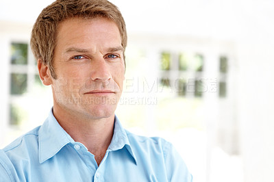 Buy stock photo Handsome mature man looking serious while indoors