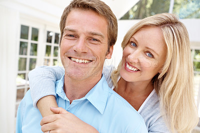 Buy stock photo Happy mature woman smiling while embracing her husband from behind