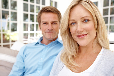 Buy stock photo Smiling mature couple sitting together - portrait