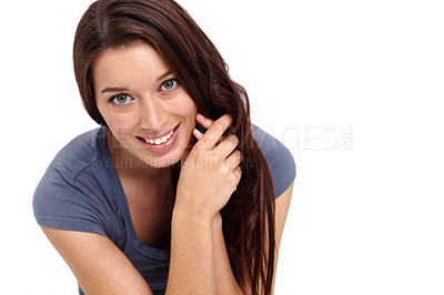 Buy stock photo Cute young brunette smiling while looking at you against a white background