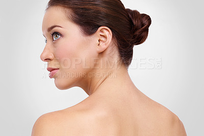 Buy stock photo Profile of a beautiful young woman with perfect skin against a white background