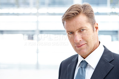 Buy stock photo A handsome mature business looking confident alongside copyspace