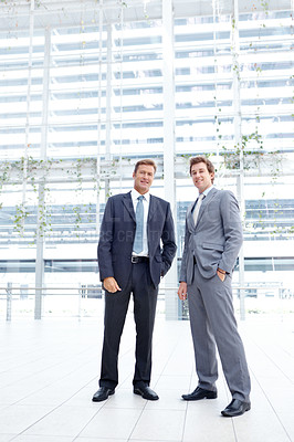 Buy stock photo Full length portrait of two businessmen standing in the lobby of their office
