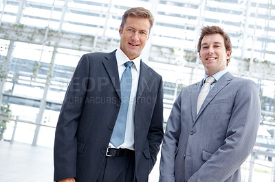 Buy stock photo Portrait of two confident executives standing together at the office
