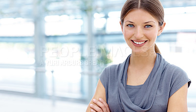 Buy stock photo A beautiful young businesswoman smiling at the camera with her arms crossed
