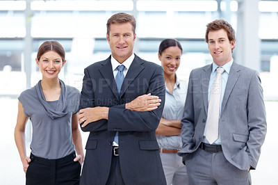 Buy stock photo A team of successful businesspeople smiling at the camera