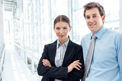 Buy stock photo Two attractive business colleagues smiling at the camera