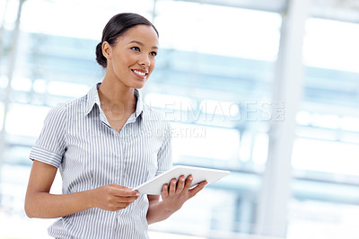 Buy stock photo Attractive young african american businesswoman using a digital tablet