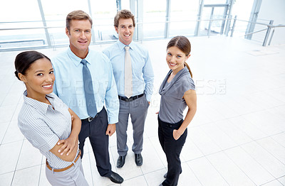 Buy stock photo Group of smiling businesspeople standing together