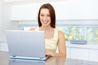 Buy stock photo A portrait of a smiling woman working on her laptop