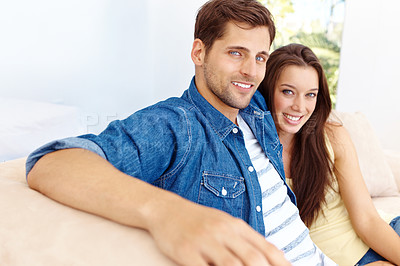 Buy stock photo A portrait of a relaxed happy couple sitting on their couch