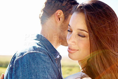 Buy stock photo Close up shot of a young man and woman with their eyes closed lightly embracing