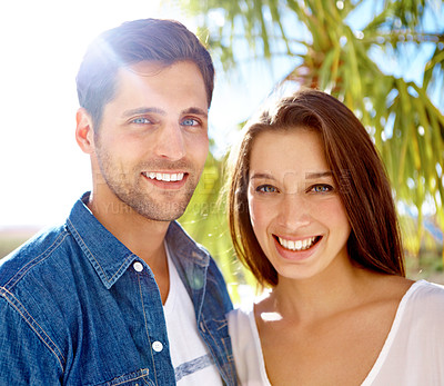 Buy stock photo Close up portrait of a happy-looking young couple enjoying a sunny day out