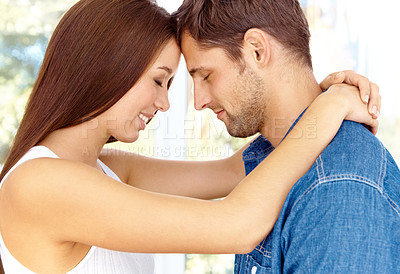 Buy stock photo Young couple sharing a romantic moment together