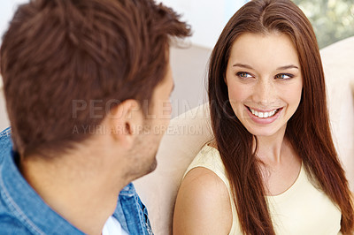 Buy stock photo Cute young couple relaxing together happily