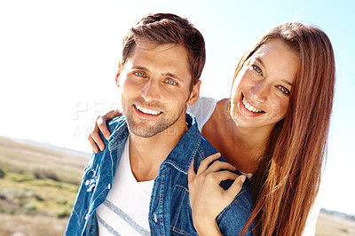 Buy stock photo Cute young couple having fun together outdoors