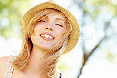 Buy stock photo A gorgeous blonde enjoying the summer breeze in the park