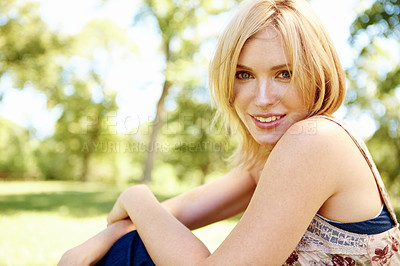 Buy stock photo Portrait of a posing smiling blonde sitting in the park