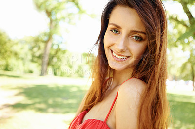 Buy stock photo Portrait of a posing brunette in the park with copyspace