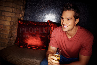Buy stock photo Portrait of a gorgeous man holding a glass of champagne in a nightclub