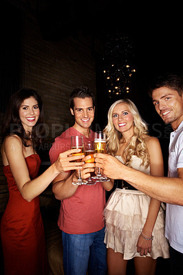 Buy stock photo Group of people toasting in a nightclub