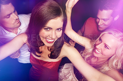 Buy stock photo High angle portrait of a group of young people dancing in a club