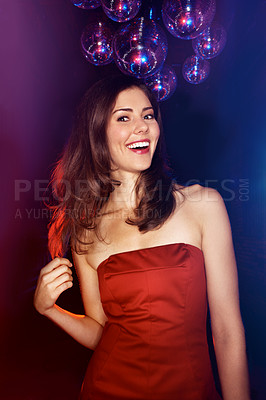 Buy stock photo Portrait of an attractive brunette woman standing in a nightclub under some disco balls