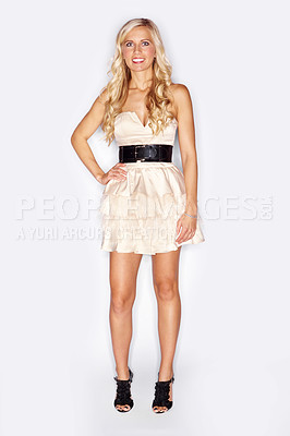 Buy stock photo Full length studio portrait of an attractive blonde woman dressed in a white cocktail dress isolated on white
