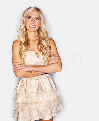 Buy stock photo Studio portrait of an attractive blonde woman dressed in a white cocktail dress