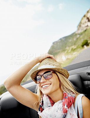 Buy stock photo An attractive young woman taking a drive on the open road