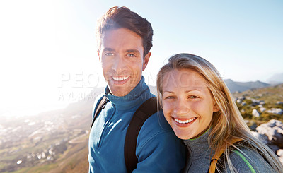 Buy stock photo Cute young couple smiling while out hiking together