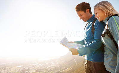 Buy stock photo Cute young couple consulting a map while out hiking together