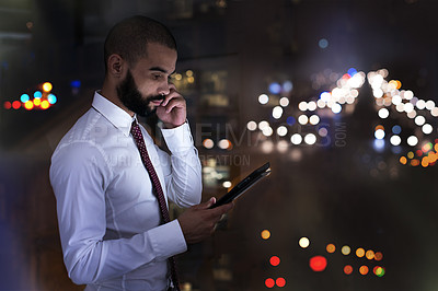 Buy stock photo Shot of a businessman talking on his cellphone late at night. Real life businesspeople shot on location. Since these locations are the real thing, and not shot in an