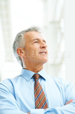 Buy stock photo Portrait of confident mature businessman with folded hands looking away