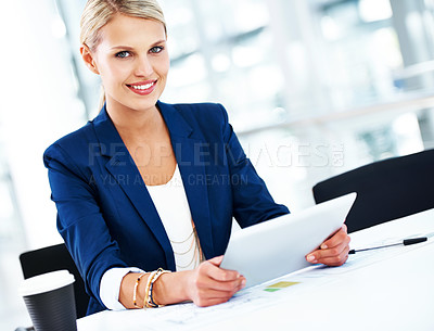 Buy stock photo A gorgeous young businesswoman working on her digital tablet